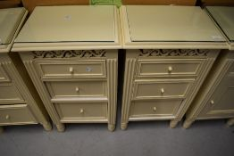 A pair of cream bedside cabinets