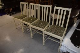 A set of four traditional dining chairs, having later painted twist frames