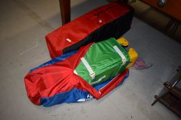 A pair of Hauck travel cots