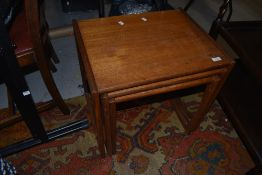 A vintage teak G plan nest of three table