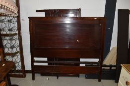 A late 20th Century mahogany pannelled bed frame including side irons and base, approx width 137cm