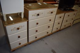 A selection of laminate pine effect bedroom furniture comprising two sets of drawers and a pair of