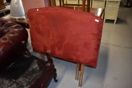 A pair of modern suedette single headboards