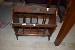 A tradtional spindle style magazine rack