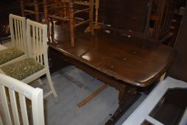 A vintage dark stained Ercol dining table, length approx. 183cm