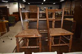 A pair of Victorian stained frame cane seated bedroom chairs