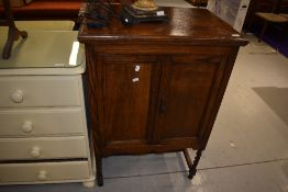 An early 20th Century oak cabinet, interior and back removed, width approx. 69cm