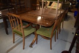 A nice quality reproduction extending dining table and set of six (four +two regency dining