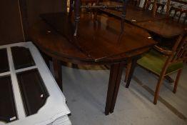 A georgian mahogany D end dining table having single centreleaf, on tapered legs, diameter 123cm,