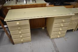 A cream painted dressing table, width approx. 145cm