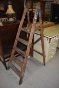 A vintage wooden step ladder