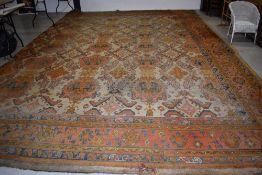 A large antique carpet square, labelled for Gillows, Lancaster, approx. 400 x 580cm