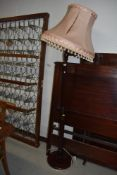 A traditional mahogany effect standard lamp