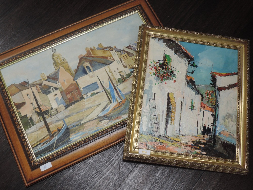 An oil painting on board, Continental townscape, indistinctly signed, 39 x 31 cm, and an oil