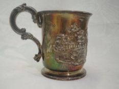 A Georgian silver Christening tankard bearing inscription dated 1891 and Repousse nursery scene with