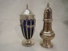 An Edwardian silver sugar caster having cage style body with blue glass liner and floral swag
