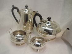 A four piece silver tea set of plain compressed circular and baluster form having banded waist,