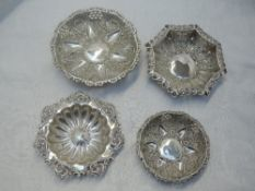 Four HM silver trinket dishes having moulded and pierced decoration, approx 151g