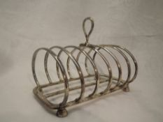 A large six slice toast rack of plain curved form, Sheffield 1922, Harrison Brothers & Howson,