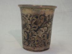 A Russian silver beaker having niello foliate scrolling decoration, flared rim and gilt interior,