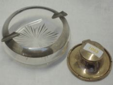 A silver capstan inkwell of plain form with raised rim and glass liner, Birmingham 1915, A & J