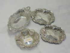 Four HM silver trinket dishes of various forms having moulded and pierced decoration, approx 121g