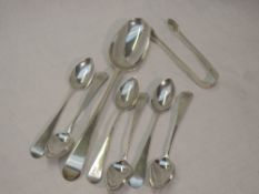 A set of six Georgian silver teaspoons of old English form bearing monogram to terminals, London