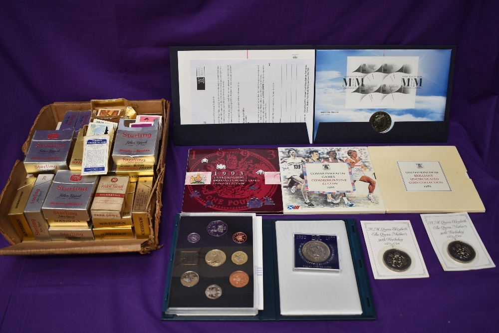A small collection of modern GB Coins including £5, four Year sets, 1986,1986 Commonwealth £2,