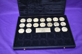 A collection of 18 different Jean Dassier Kings and Queens Medallions in presentation box