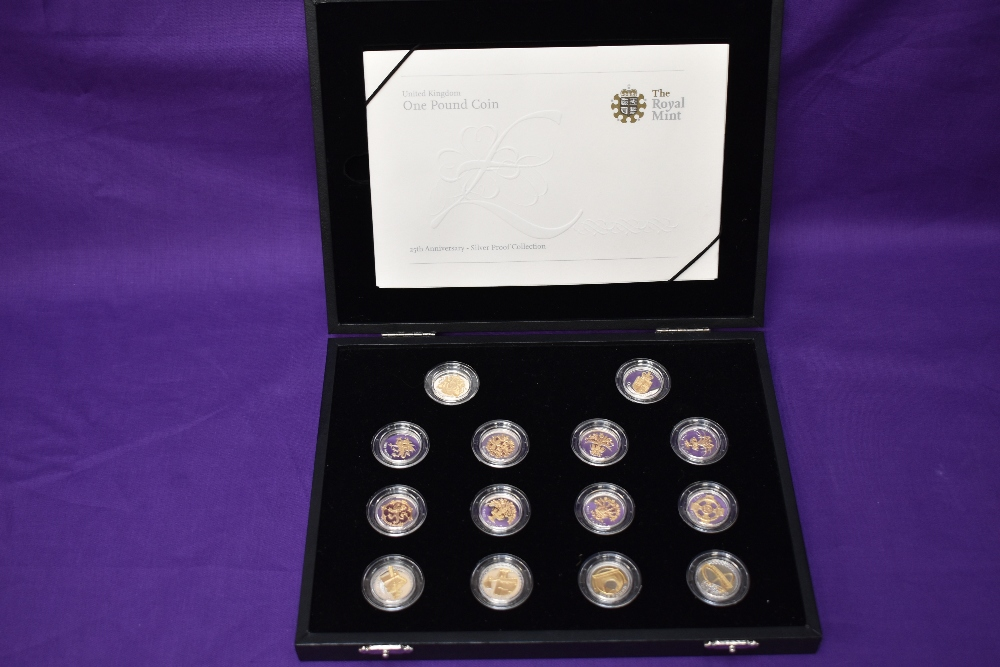 A Royal Mint GB 2008 set of 14 different Silver £1 Coins with gold plating to reverse of design,