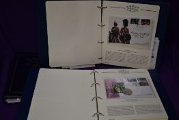 Two albums of GB & Commonwealth Coin Covers and First Day Covers, along with an empty album