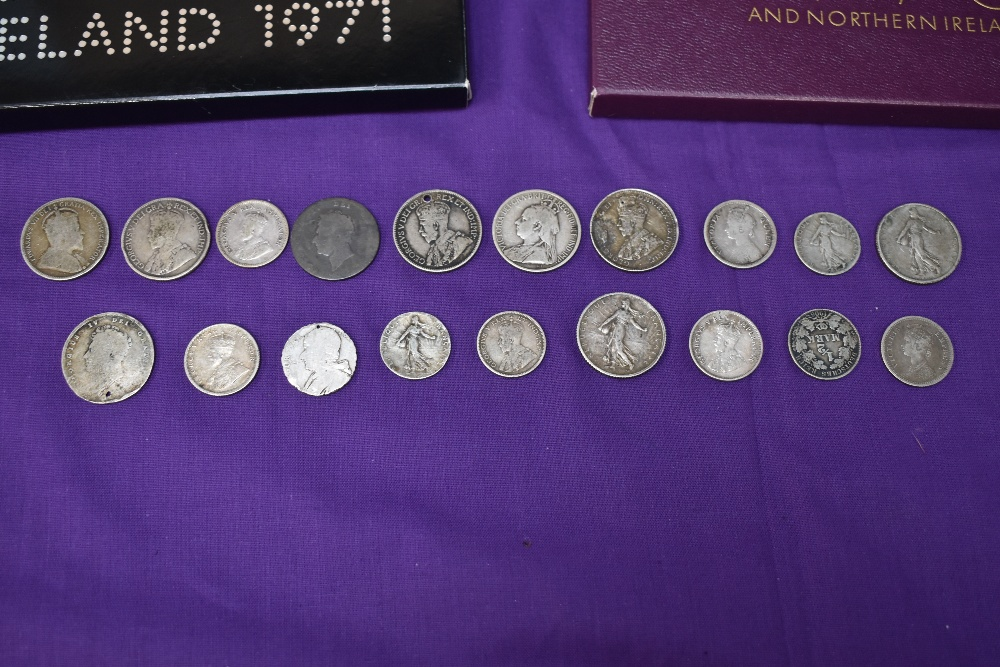 A UK coin collection including three year sets 1970 x2 & 1971, uncirculated £1, along with world - Image 2 of 2