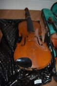 A traditional violin having two piece back, approx. 14inches, labelled 'metropole, made in