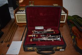 A Buffet Crampon clarinet in fitted case , model E13 (B), serial number K139960 with additional