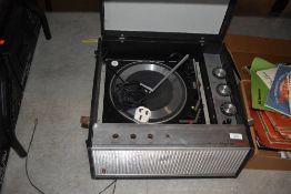 A vintage Bush transistorise gramophone, having 4 speed Garrard deck