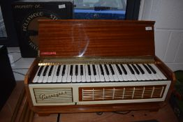 A vintage sapele cased electric Pianorgan II by Farfisa, complete with legs