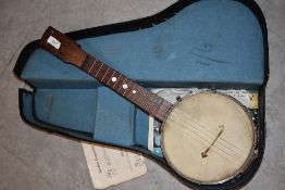 An early 20th Century ukulele banjo , in semi hard case, no makers mark, retail stamp to back of