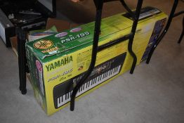 A Yamaha PSR-195 electronic keyboard, boxed, and a Stagg stand