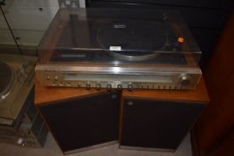 A Sanyo home stereo system G2003 with Maudant Pageant series 2 speakers with covers