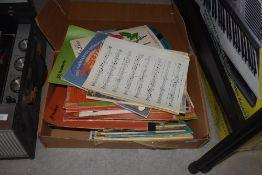 A box of mixed sheet music, mainly Hammond Organ pieces