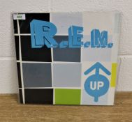 A vinyl copy of REM's ' Up ' long player - like the other REM albums listed these sold more on CD at