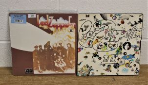 A lot of two Led Zeppelin albums - a double repress with extras and a later issue on orange, green