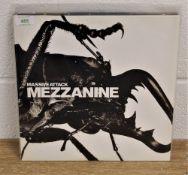 A copy of 'Mezzanine ' by Massive Attack ex / ex