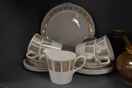 A part tea service by Queen Anne Ridgway having white and gold retro design