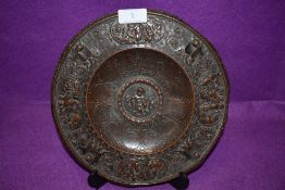 An antique bronze footed tazza or plaque decorated with cherubs and signs of the zodiac bearing