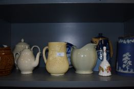 A varied lot of vintage ceramics and glass including jugs, tea pots and decanters.