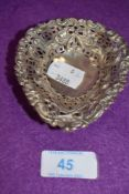 A small Victorian Hm silver pin dish having pierced rapousse decoration