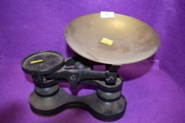 A set of cast kitchen balance scales by Victor having brass bowl