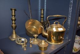 A selection of fire side items including brass spirit kettle candle sticks and sauce pan