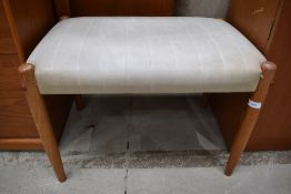 A vintage PVC dressing table stool having teak legs